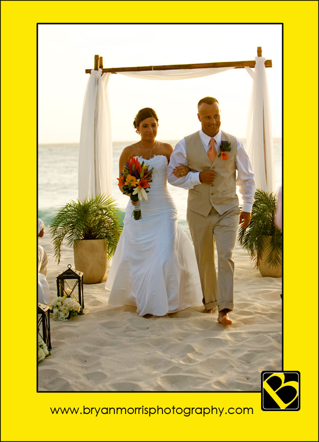 Walking down the sand aisle as Mr & Mrs Vazquez
