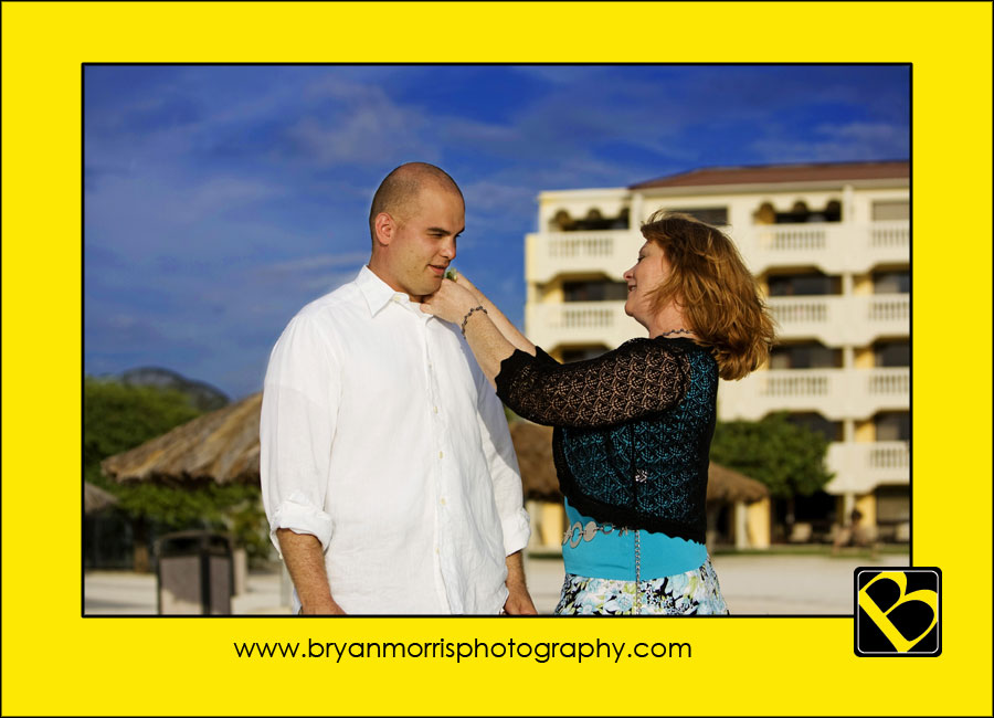 Mother Pinning Boutonniere On Groom